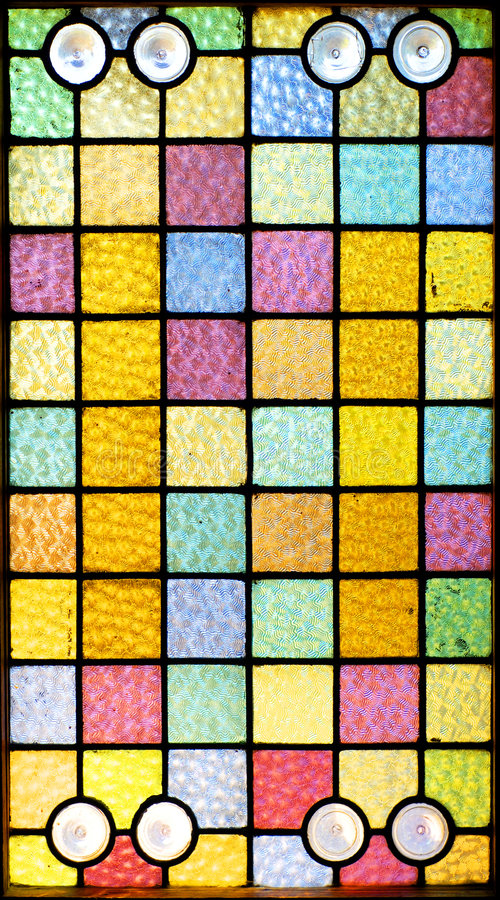 Stained Glass Window. A stained glass window of squares royalty free stock image