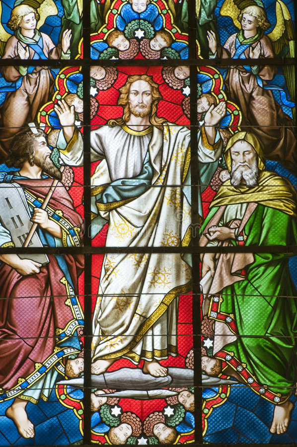 Stained glass window. Detail of coloured Stained glass window with jesus stock photos