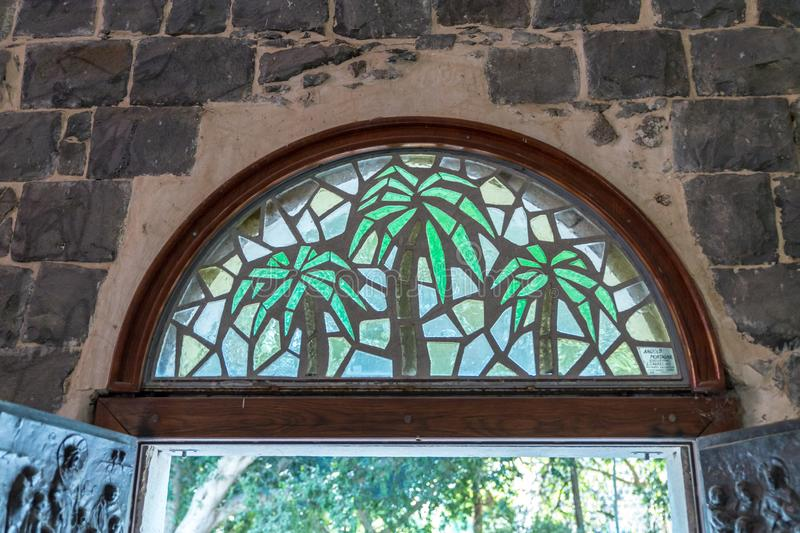 Stained glass window above the front door to the Church of the Primacy of Saint Peter located on the shores of the Sea of Galilee royalty free stock image