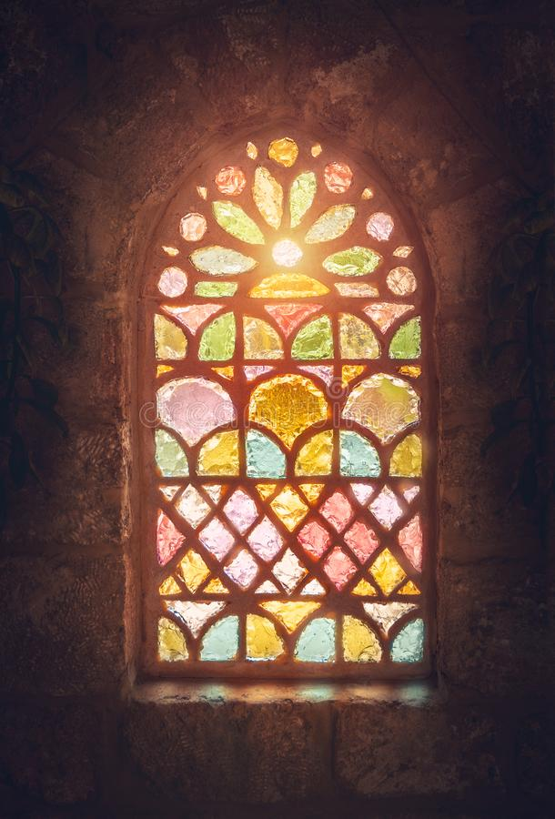 Stained glass window. Amazing colorful window of an ancient church, house of god, place of worship, old ancient cathedral of Lebanon stock image