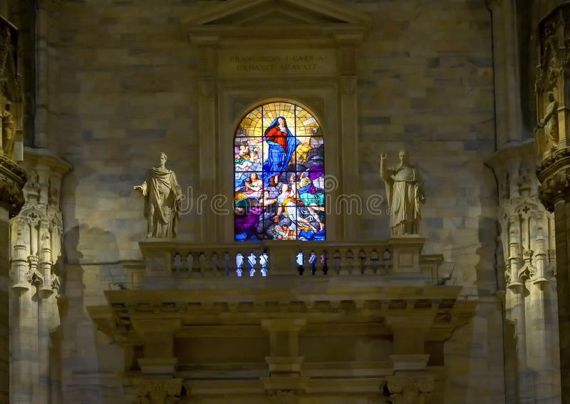 Stained glass window of the ascendance of Mary, inside the Milan Cathedral, the cathedral church of Milan, Lombardy, Italy. Pictured is a stained glass window stock photo