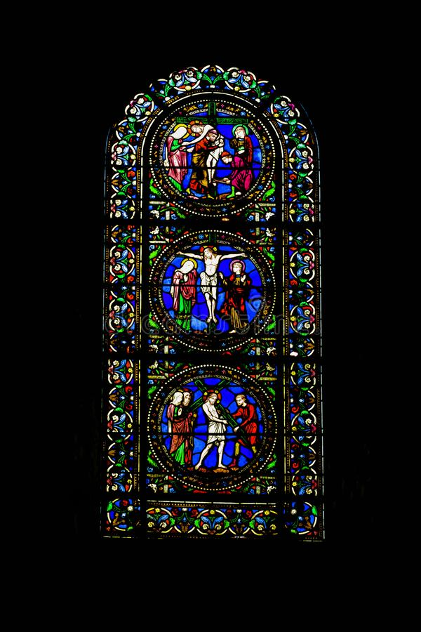 Stained glass window at Cathedral of Saint Julian in Le Mans, Maine, France. Stained glass window at Cathedral of Saint Julian / Cathedrale St-Julien du Mans in stock images