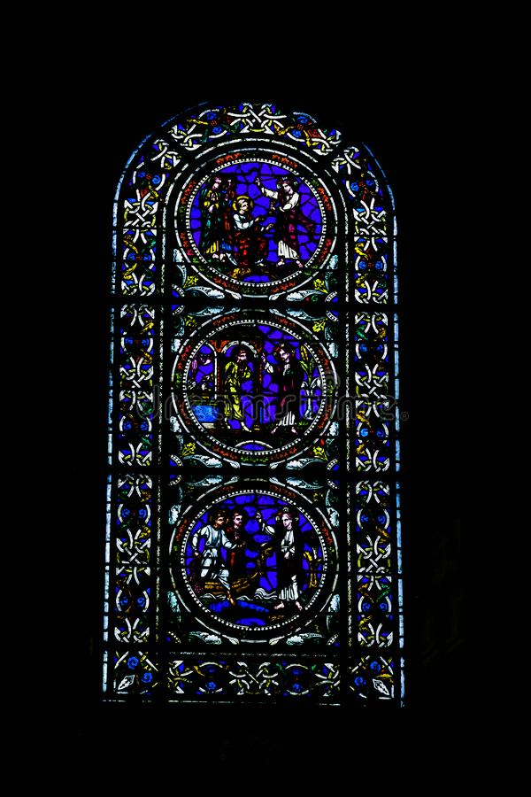 Stained glass window at Cathedral of Saint Julian in Le Mans, Maine, France. Stained glass window at Cathedral of Saint Julian / Cathedrale St-Julien du Mans in royalty free stock photos