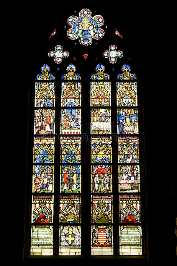Stained glass window in catholic church stock photos
