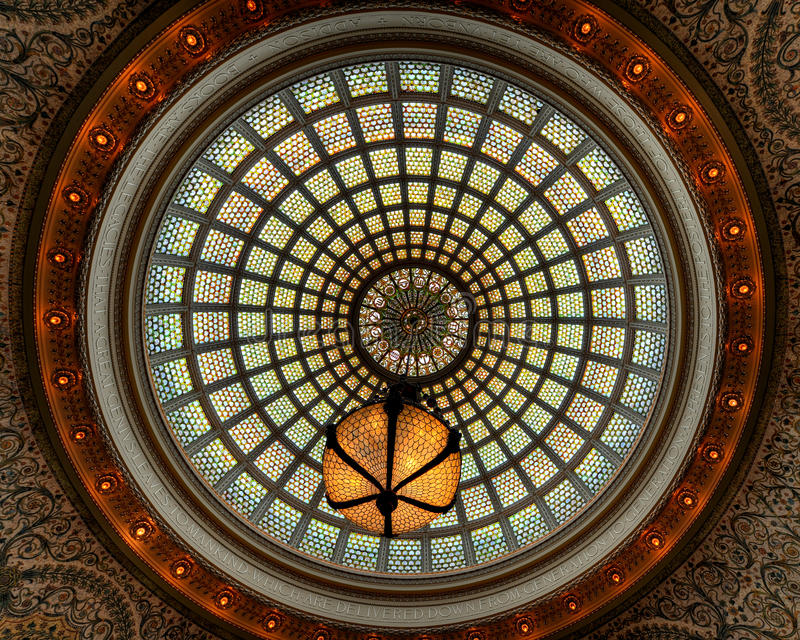 Stained glass window ceiling dome. Stained glass ceiling dome with hanging chandelier at the Chicago Cultural Center royalty free stock images