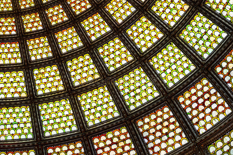 Stained glass window ceiling dome. Closeup of stained glass window ceiling dome at the Chicago Cultural Center stock photo