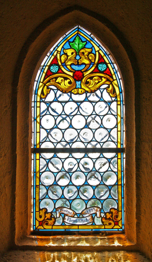 Stained glass window of church. In Heilingenblut, Austria royalty free stock photography