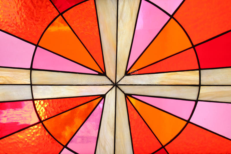 Stained glass window in the church. Stained colorful glass window in the church stock image