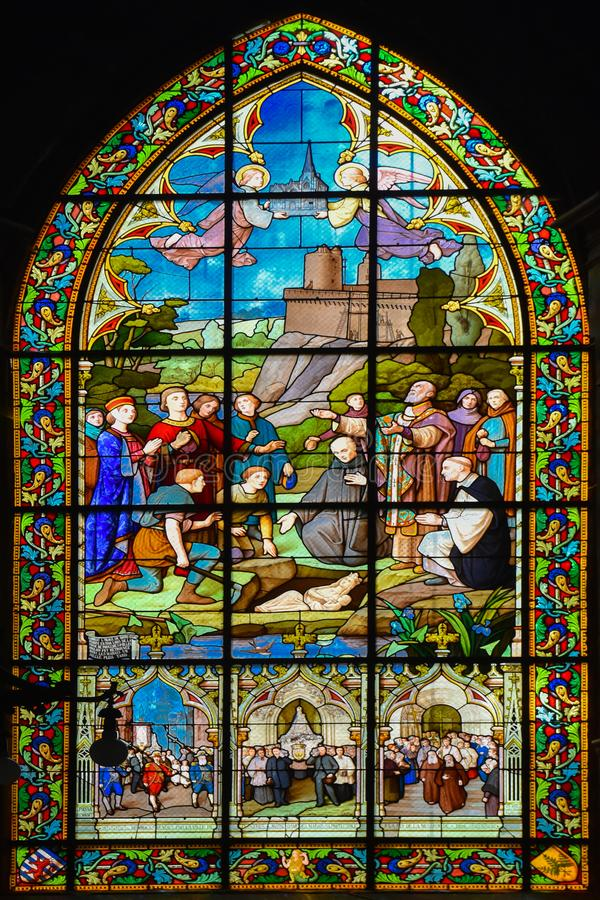Stained glass window of the Church Saint-Sulpice of Fougeres. royalty free stock image