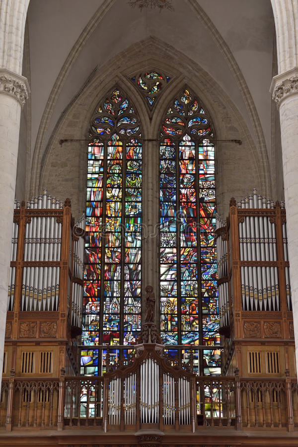 Stained glass window in church Saint Walburga. OUDENAARDE, BELGIUM-JUNY 23, 2015: Stained glass window in church Saint Walburga, known from 11 century royalty free stock photography