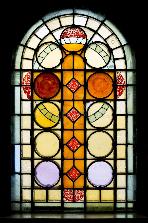 Stained glass window in church stock image