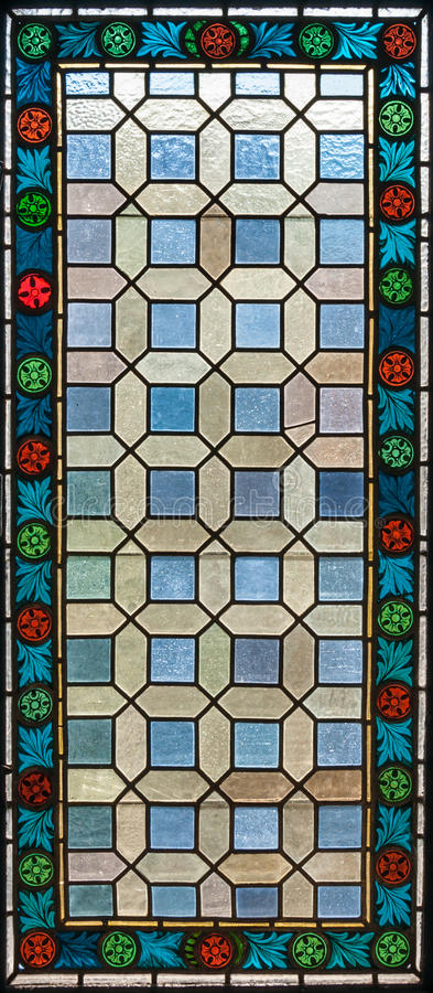 Stained glass window. Of colored glass stock image