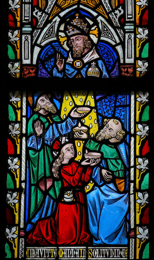 Stained Glass window. Depicting the Bible verse Deuteronomium 8: 16 in St. Truiden, Belgium. He fed you with manna in the desert stock images