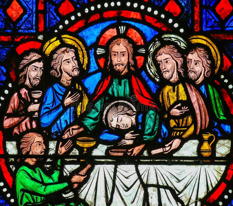 Last Supper on Maundy Thursday - Stained Glass in Tours. Stained glass window depicting Jesus and the Apostles at the Last Supper on Maundy Thursday in the royalty free stock photography