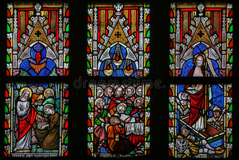 Stained glass window depicting Scenes in the Life of Jesus Chris. T in the Cathedral of Saint Truiden in Limburg, Belgium stock photo
