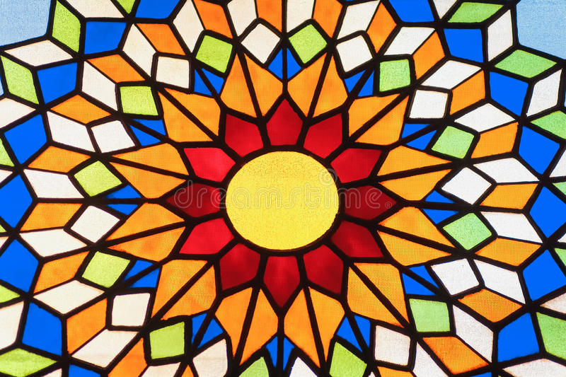 Stained glass window. In the form of the sun stock photo