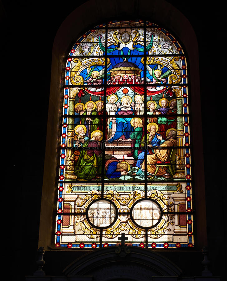 Stained glass window. In a French old church at Belfort stock photo