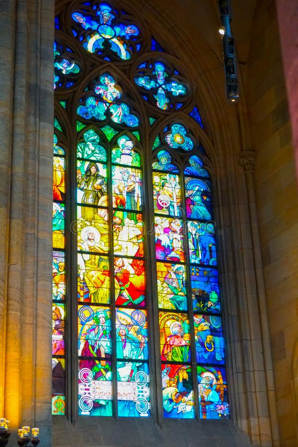 Stained glass window with icon in st. Vitus Cathedral in Prague, Czech Republic. royalty free stock photography