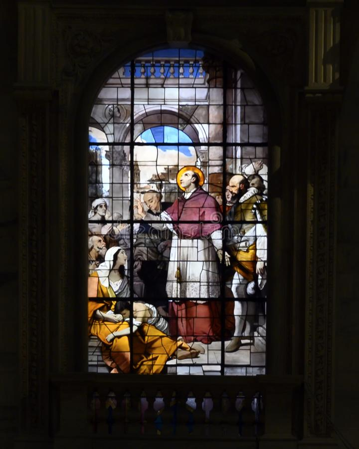 Stained glass window inside the Milan Cathedral or Duomo di Milano, the cathedral church of Milan, Lombardy, Italy. stock photos