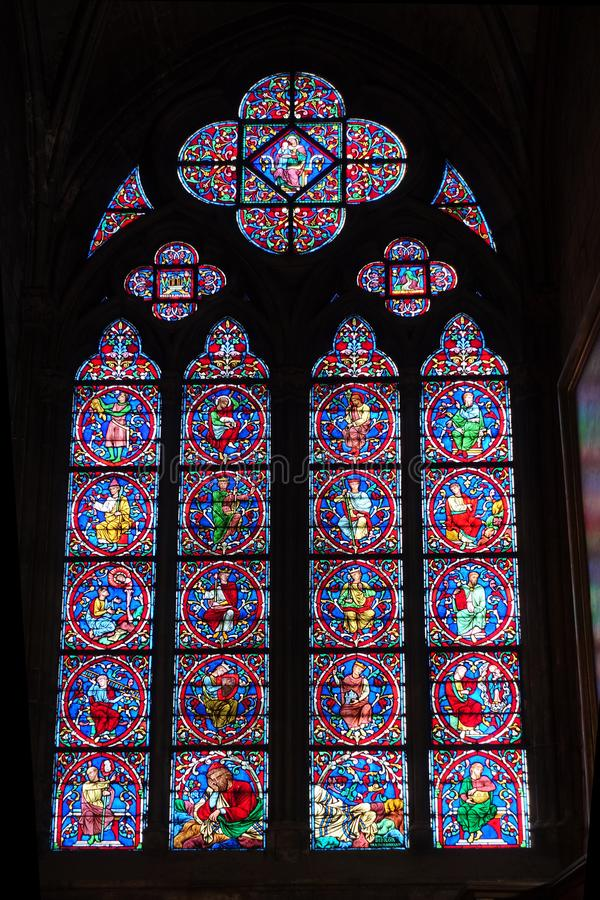 Stained Glass Window Interior Notre Dame Cathedral. Interior view of vibrant stained glass windows of Notre Dame Cathedral in Paris. Photographed March 2017 stock images