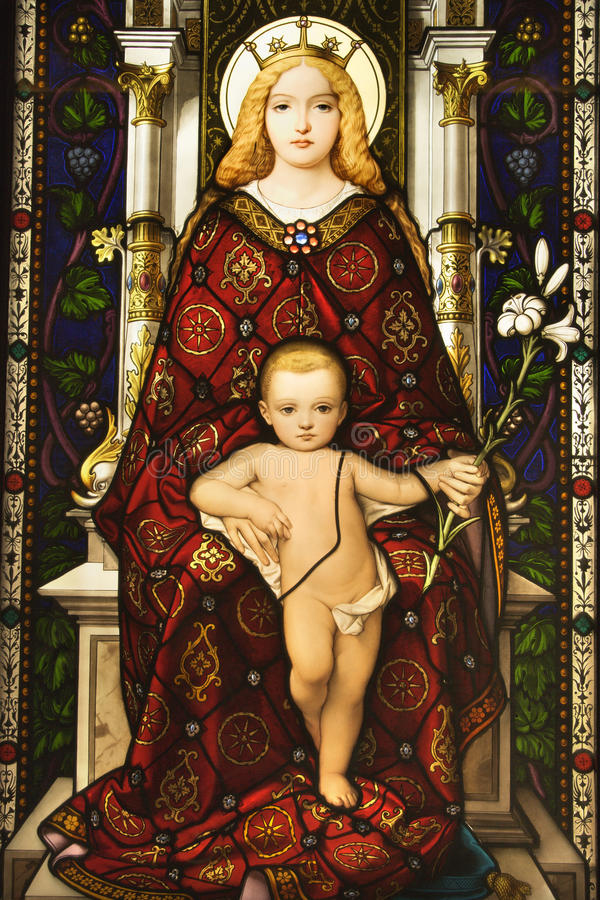Stained Glass Window of Madonna and Child. Stained glass window showing image of Madonna and Child. Vertical shot stock image