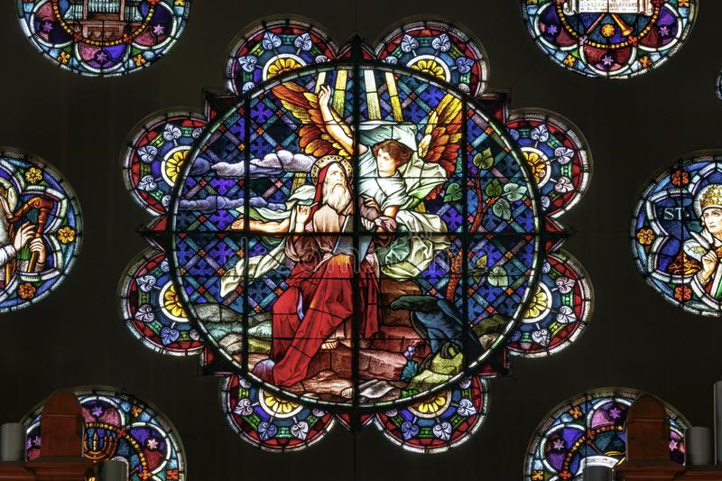 Stained Glass window at the Saint John the Evangelist church portraying St. John. Indianapolis - Circa October 2019: Stained Glass window at the Saint John the royalty free stock photo