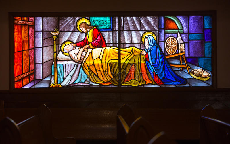 Stained glass window. Several hundred year old stained glass window in a church tulip royalty free stock image