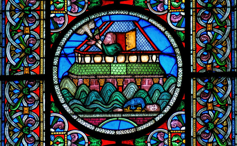 Stained glass window depicting Noahs Ark on the water. Stained glass window depicting Noah's Ark floating on the water with the dove returning after finding no royalty free stock images