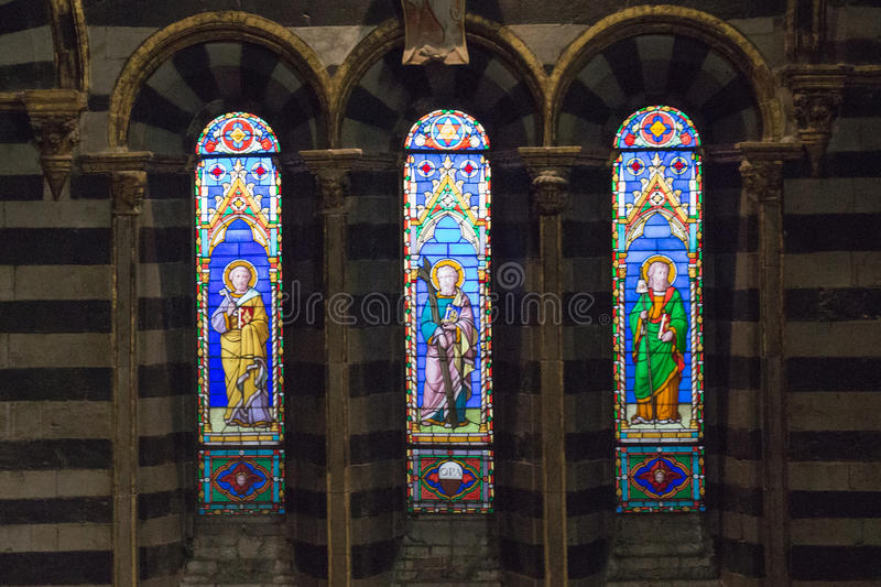 Stained glass window of the Siena Cathedral. View of cathedral interior from the passageway under the roof. Tuscany, Italy. stock photography