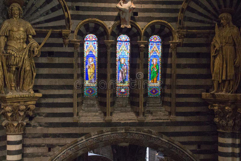Stained glass window of the Siena Cathedral. View of cathedral interior from the passageway under the roof. Tuscany, Italy. stock photo