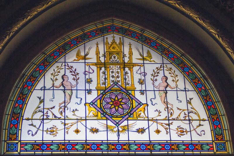 Stained glass window in St Stephen's cathedral, Budapest, Hungary stock images