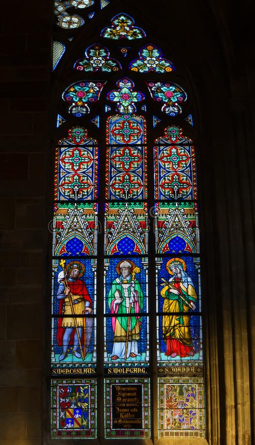 Stained glass window in St. Vitus Cathedral, Prague stock image