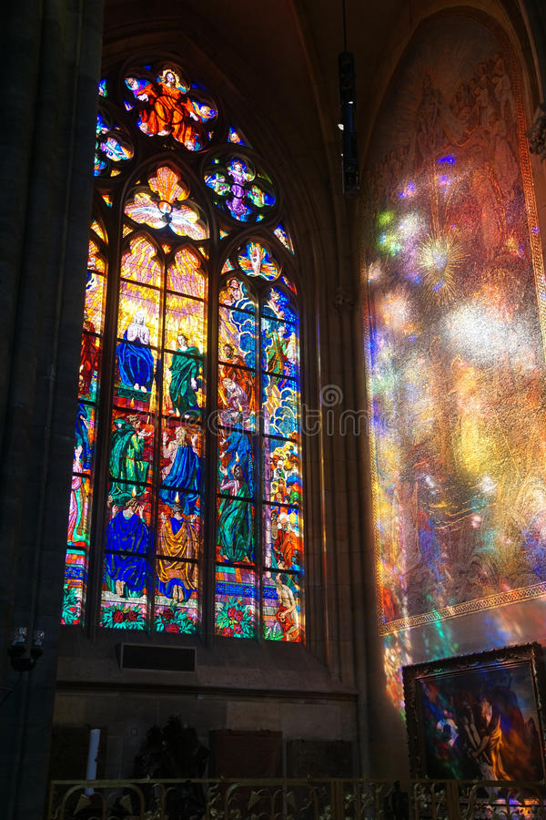Stained glass window in St Vitus Cathedral stock photography