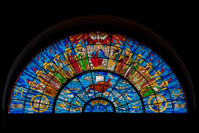 Stained glass window The twelve apostles. In a church in Hungary. Blue is the dominating colour royalty free stock images
