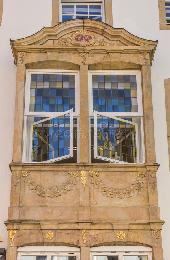 Stained glass windows on a facade in Osnabruck. Germany royalty free stock image