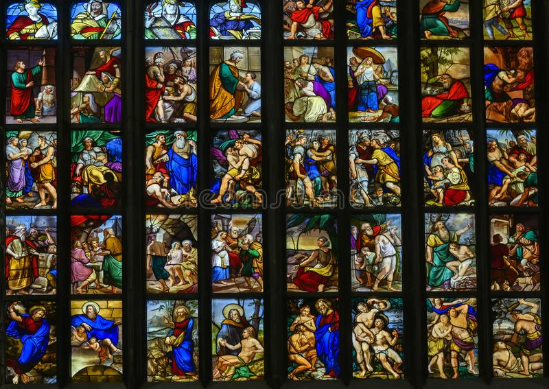 Stained glass windows inside the Milan Cathedral or Duomo di Milano, the cathedral church of Milan, Lombardy, Italy. Pictured are stained glass windows inside royalty free stock photography