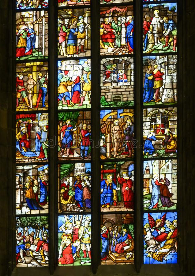Stained glass windows inside the Milan Cathedral or Duomo di Milano, the cathedral church of Milan, Lombardy, Italy. Pictured are stained glass windows inside stock photos