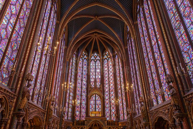 Stained glass windows inside the Sainte Chapelle a royal Medieval chapel in Paris, France.  stock photography