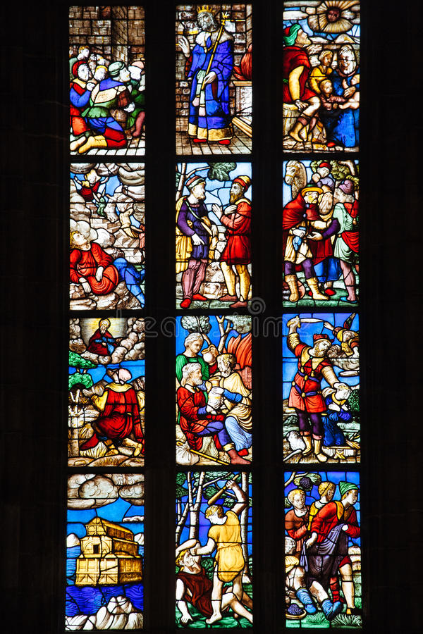 Stained glass windows in Milan Duomo. Vertical royalty free stock photo