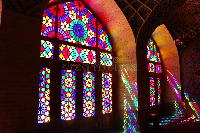 Interior view of Nasir-ol-molk Mosque in Shiraz, Iran. Stained glass windows of the mosque. Interior view of Nasir-ol-molk Mosque in Shiraz, Iran royalty free stock photo