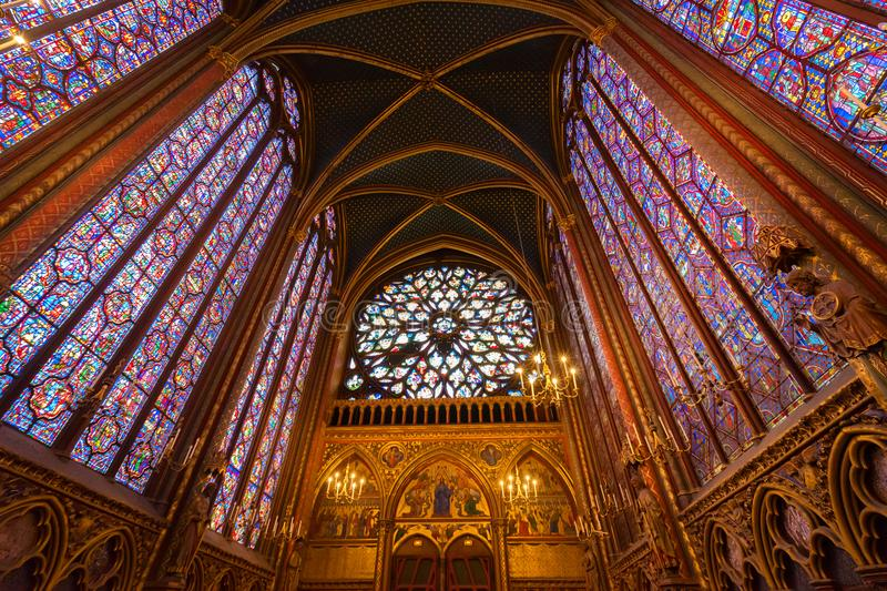 Stained glass windows of Saint Chapelle. With rose window, medieval church of 13c., Paris France royalty free stock photos