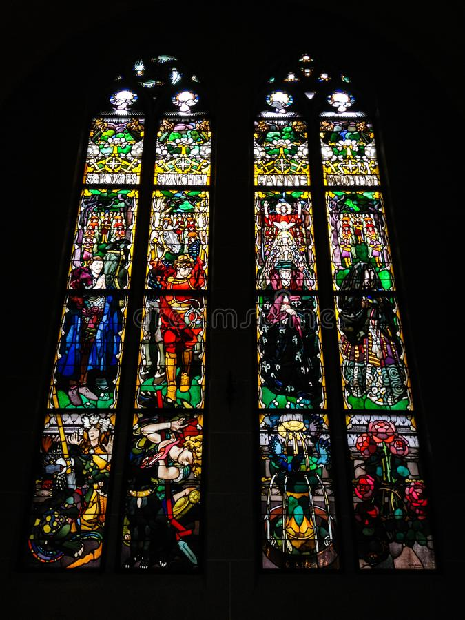 Stained Glass Windows in St. Nicolas cathedral, created by the Polish painter Jozef Mehoffer between 1896 and 1936, Fribourg royalty free stock photo