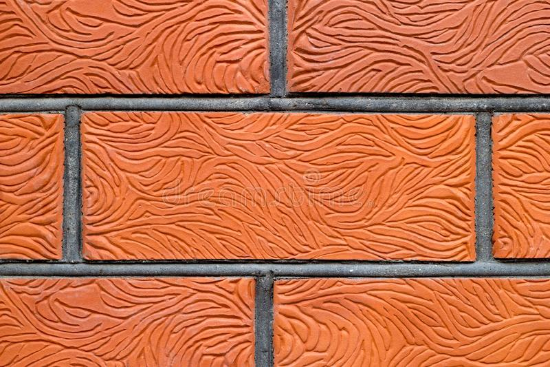 Stained red brick wall background. Copy space in central part of image. Close-up. stock photos