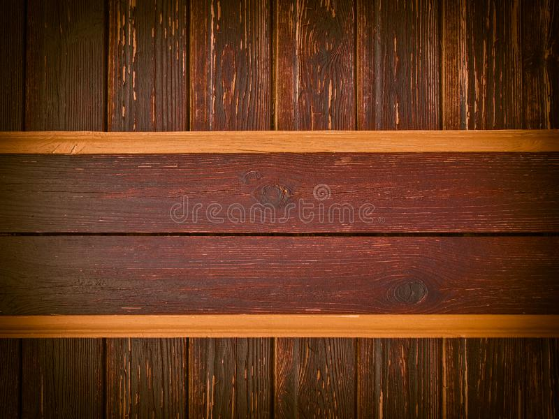Stained wood plates on old ragged wall stock photo