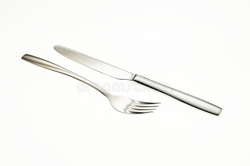 Stainless fork and knife royalty free stock images