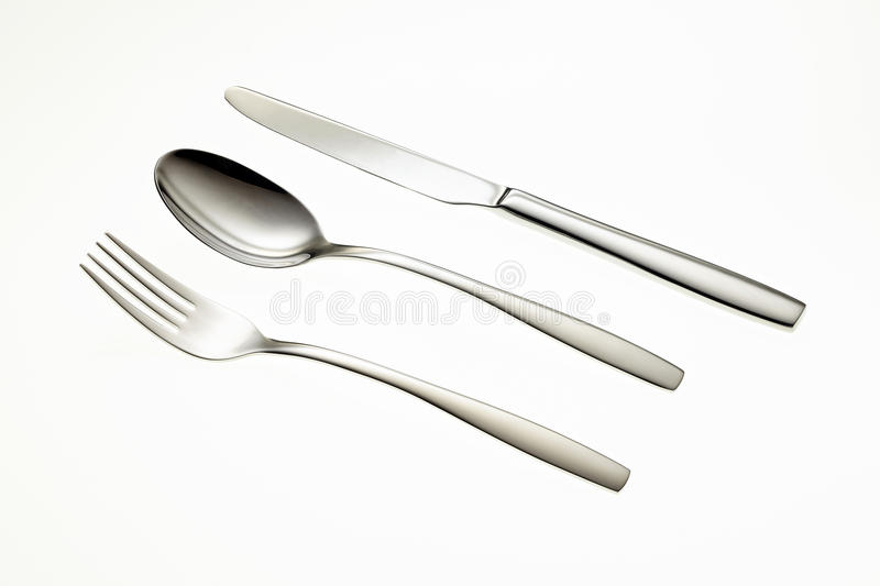 Stainless fork, spoon and knife stock images