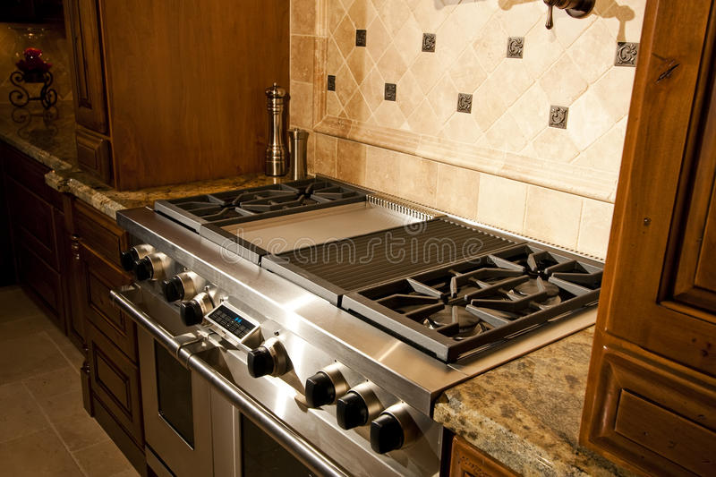 Stainless kitchen oven and range stock photography
