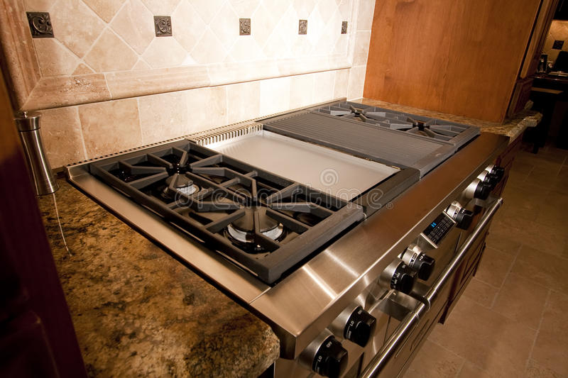 Stainless kitchen oven range and hood royalty free stock image