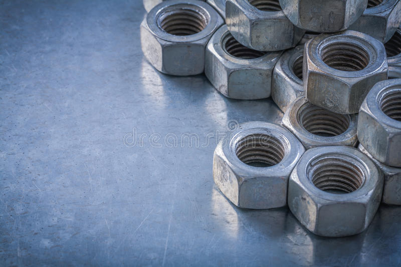 Stainless screw-nuts on metallic background maintenance concept.  royalty free stock photos