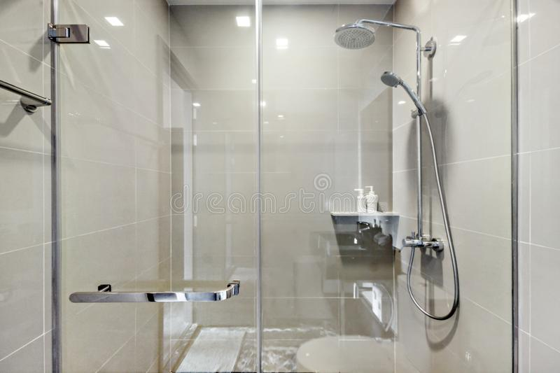 Stainless shower on bathroom royalty free stock photography